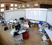 MobileRealtyApps.com employees in their workspace.
