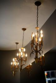 Lighting from the old space was repurposed in the remodeled layout.