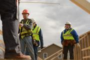 Sue Haigh (right), president and CEO of Twin Cities Habitat for Humanity