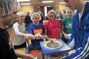 Students from the Central High School National Honor Society help out.