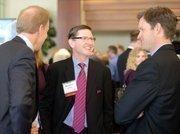 Mike Kasner (center),CFO of Comm-Works