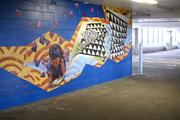 Art on the walls of the building's parking garage