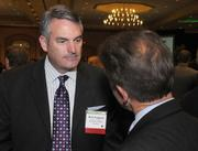 Rick Fergesen (left), of Woodbury Financial Services, and Ron Hafner of Wipfli.
