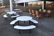 Outdoor cafeteria seating butts up against a wild life refuge.