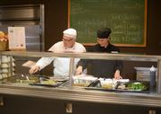 """Taher Corporate Chef Paul """"The Professor"""" Laubignat (left) and chef Jen Schulties. Taher Inc. designed the upgrades to Aveda's cafeteria."""