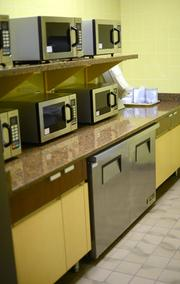 There are several microwaves for employees who bring their lunch