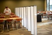 Dividers separate the cafeteria's regular seating area from a catered buffet that is being used by an internal Cargill employee group.