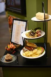 Food specials of the day are put on display on a table where patrons enter the cafeteria.