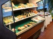 A grab-and-go area contains pre-made salads and sandwiches for people who are in a hurry.