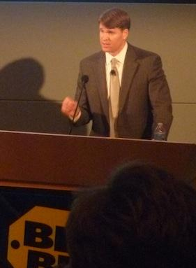 Mike Mikan, interim CEO for Best Buy, talks at the company's shareholder meeting on Thursday.