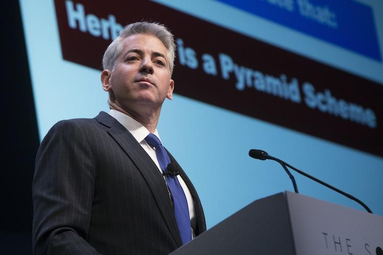 """William """"Bill""""Ackman, founder and chief executive officer of Pershing Square Capital Management LP, pauses while speaking in front a screen displaying """"Herbalife is a Pyramid Scheme"""" during a presentation in New York on Thursday."""