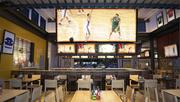 A rendering of the inside of a redesigned Buffalo Wild Wings restaurant.