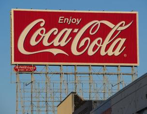 Coca-Cola says its profit rose 13 percent in the fourth quarter as the world's biggest beverage company sold more of its drinks in emerging markets and benefited from a shift in the calendar that resulted in two extra selling days.