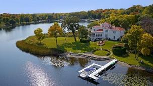 The house is located on 3.65 acres of land on Lake Minnetonka, and has 1,000 feet of shoreline.