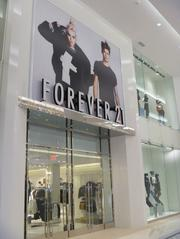 Forever 21's first-floor entrance, featuring a two-story display.