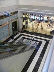 Forever 21's basement entrance and the courtyard area in front of it.