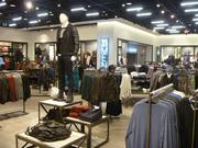 The new, larger store has a men's clothing section that was not offered at the previous location.
