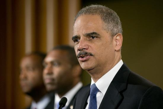 Eric Holder, U.S. attorney general, speaks during a news conference with Tony West, acting associate attorney general, center, and Andre Birotte Jr., U.S. attorney for the central district of California, in Washington, D.C., on Tuesday.