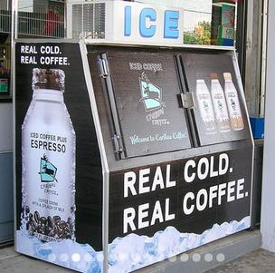 An example of an ad wrap on an ice vending machine that can be produced by The Wide Format Shop, which AllOver Media has purchased.