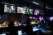 The bar with video screens in the background atthe bar atInsert Coin(s) Videolounge GameBar in Las Vegas