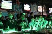 Men playing video games at the bar atInsert Coin(s) Videolounge GameBar in Las Vegas