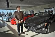 Karl Schmidt of Morrie's Automotive, standing with some Maserati cars.