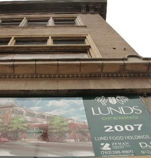 A sign on the Lunds building at 1201 Hennepin Ave. from about five years ago announcing an opening that never happened. Now Lunds is about ready to break ground on the site and expects to have the grocery open next summer.