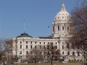 Minnesota state legislators on Wednesday proposed bipartisan legislation creating a health-insurance exchange that would be funded partly by a 3.5 percent surcharge on premiums.