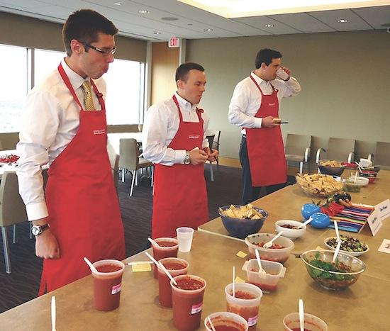Attorneys judge a staff salsa and guacamole contest during Oppenheimer Wolff & Donnelly's Staff Appreciation Fiesta Week.