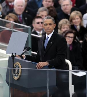 President Barack Obama pauses during his inaugural address in Washington, D.C., on Monday. As he enters his second term, Obama has shed the aura of a hopeful consensus builder determined to break partisan gridlock and adopted a more confrontational stance with Republicans.