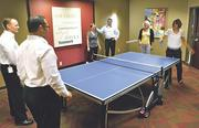 To encourage camaraderie, build teamwork and promote fun in the workplace, Signature Bank has a ping pong table in its new breakroom area.