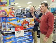 Target CEO Gregg Steinhafel checks out Black Friday sale items after Target opens its doors on Thanksgiving in Bloomington.