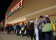 Shoppers line up outside a Dallas-area Target at 8:30 p.m. on Thanksgiving.