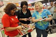 Target employee Melba Breidenstein (left) assists Angela McCrary (center) and Rebecca Freeman at a store in the Dallas area on Thanksgiving.