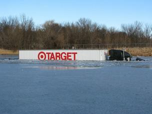 A Target truck slid off a I-94 near Monticello Friday and into this pond.