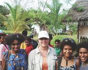 Travel Beyond Consultant Sue Rovegno, center, visited Papua New Guinea to meet residents of a local village.
