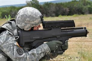 The XM25 rifle, which is an air burst grenade launcher that fires 25mm grenades that are set to explode in mid-air at or near the target.