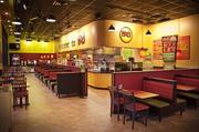 The inside of a Moe's.