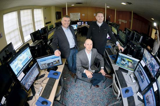 From left, David Abbott, Tom Masterman and Rob Pyhythian run SportsData from the St. Thomas University campus in St. Paul