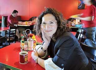 Stephanie Shimp, co-founder of Blue Plate Restaurant Co., at the Highland Grill. 'We've wanted to get into Uptown for years,' she said of the new location.