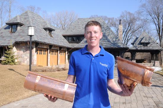 Ryan Grambart shows off the high-end copper gutters sold by his 3-year-old company, CopperSmith Gutter Co. The products cost about five times as much as standard aluminum gutters.