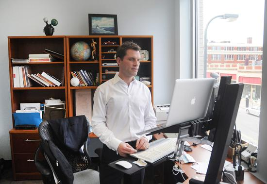"Chris Schermer checking his email for ""any fires"" in the Minneapolis office of his marketing agency, Schermer Inc."