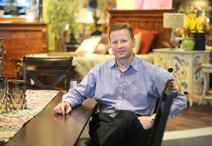 Jim Huseby, Becker Furniture World's president, is adding new Twin Cities stores. He's pictured in the Burnsville location.