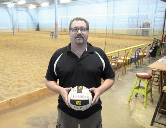 Bob Guptil opened Hidden Beach, an indoor sand volleyball court facility, in converted industrial space last fall. He offers adult league play and youth volleyball camps at the facility.