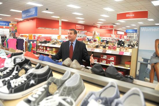 Bryan Everett, Target's senior vice president of stores, shows off new features at the Shoreview SuperTarget, including lower shelves to improve sightlines and more benches for trying on shoes.
