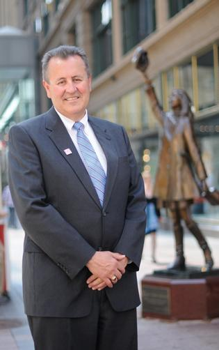 Mark Stenglein on Nicollet Mall, with Mary Tyler Moore statue behind him