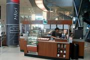 A Caribou Coffee kiosk just opened in the building