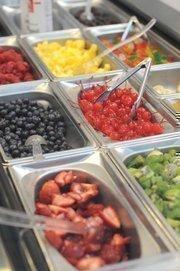 Yogurt shops, such as Freeziac, are finding custom toppings popular.