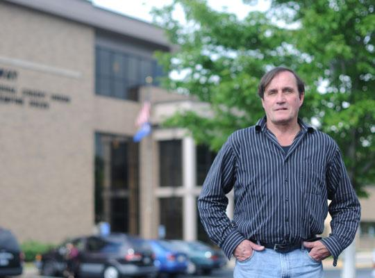 Duane Gatzke, an employee of the Minnesota Pollution Control Agency, expects to borrow from Hiway Federal Credit Union (background) if a state shutdown lasts more than two weeks.