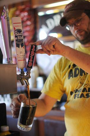 Vinny Ramm, a bartender at Adrian's Tavern in Minneapolis, serves up New Ulm Brewing's 1919 root beer from the tap.